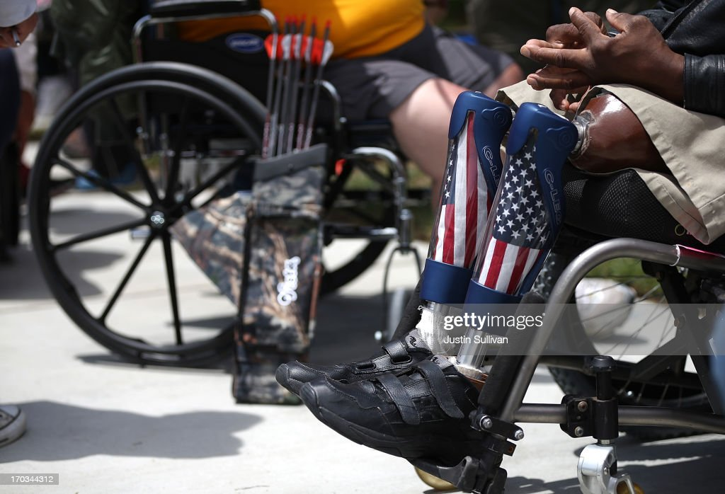 A disabled veteran with prosthetic legs looks on during the archery competition at the inaugural Valor Games Far West on June 11 2013 in Foster City...