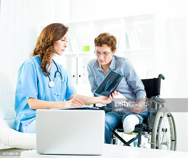 Disabled Woman At Doctors Office.