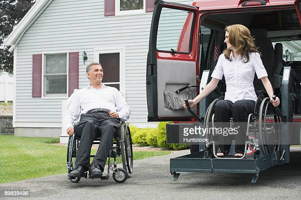 Disabled woman deboarding from a wheelchair accessible car