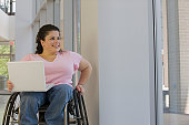 The woman in the wheelchair has Spina Bifida and Myelo Meningeal Paraglegia