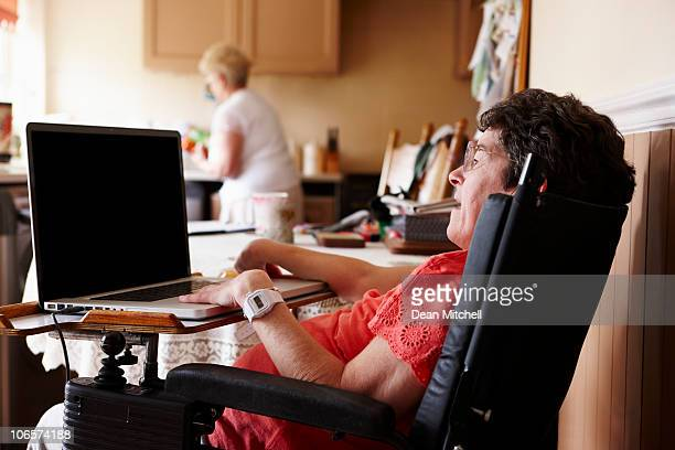 Disabled woman with hands on a laptop keyboard