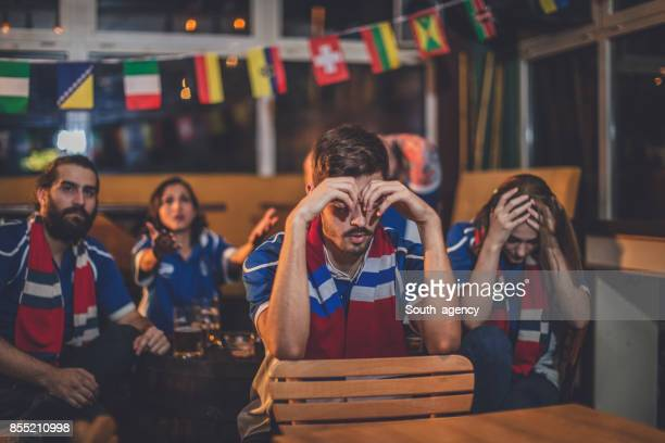 Disappointed fans at the bar