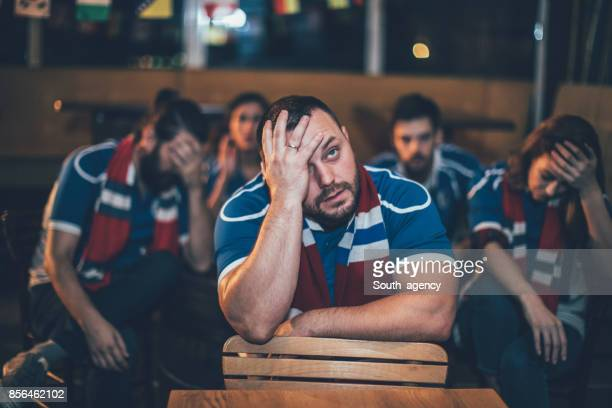 Disappointed group of sport fans