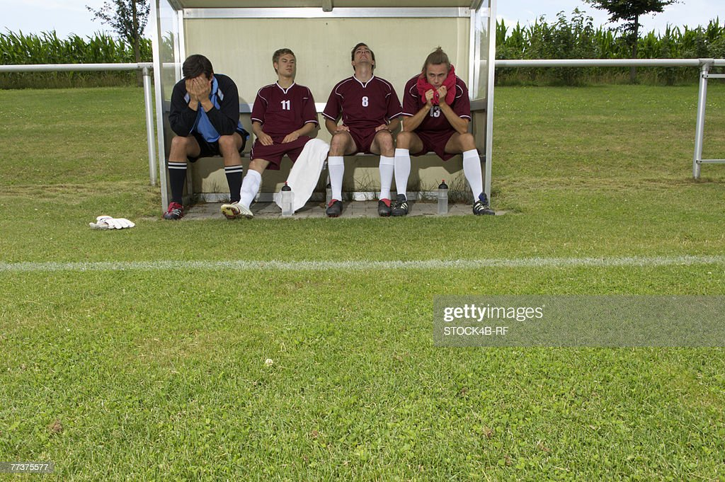 Disappointed kickers sitting on substitutes' bench
