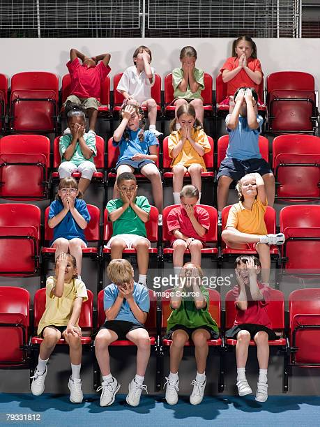 Disappointed kids at stadium