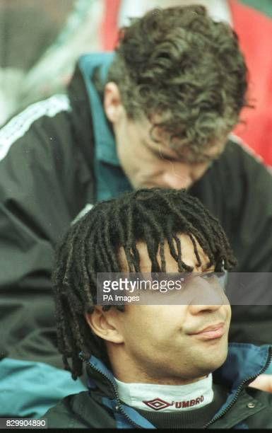 A disappointed manager Ruud Gullit watches on as Middlesbrough move out of the relegation zone by beating Chelsea with a Juninho goal Pix Owen...
