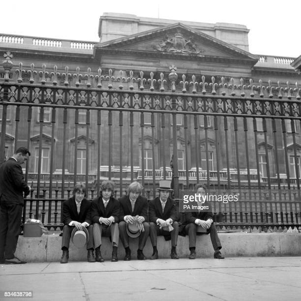 Disappointed pop group outside Buckingham Palace today who unsuccessfully tried to gain admission to the first of the season's three garden parties...
