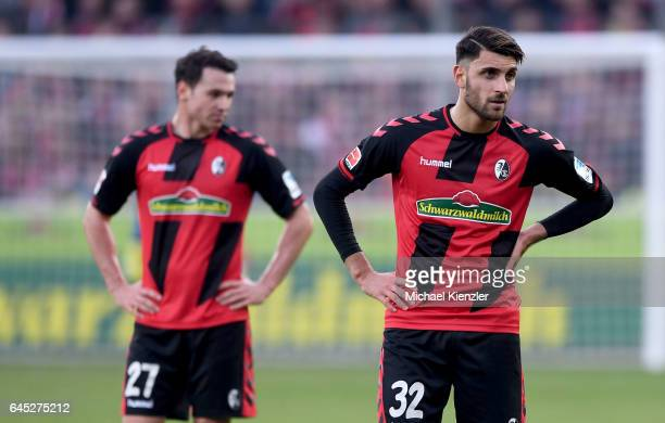 Disappointed Vincenzo Grifo and Nicolas Hoefler of SC Freiburg standing on pitch during the Bundesliga match between Sport Club Freiburg and Borussia...