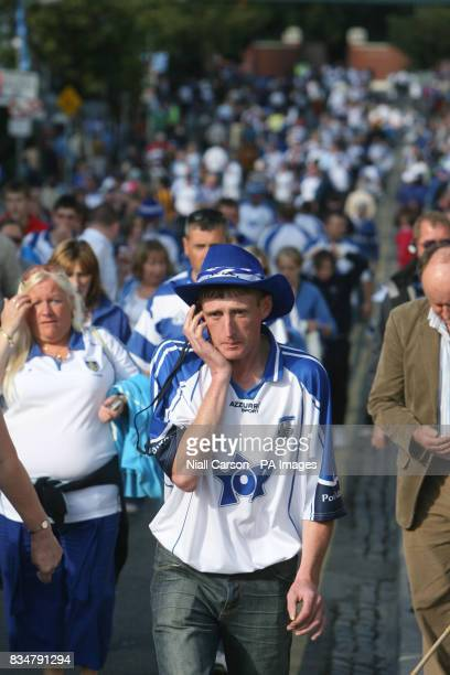 Disappointed Waterford fans leave after their team was beaten Killkenny who have now won three All Ireland hurling championships in a row outside...