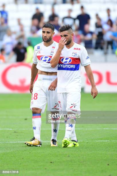 Disappointment for Nabil Fekir of Lyon and Jordan Ferri of Lyon as their side concedes a late equaliser during the Ligue 1 match between Olympique...