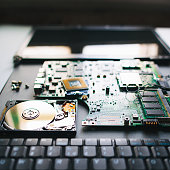 Broken laptop. Electronil components of pc: keyboard, hdd, motherboard (board), cpu (processor), monitor (display)