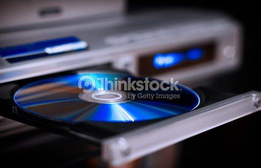 DVD disc inserting to player : Stock Photo
