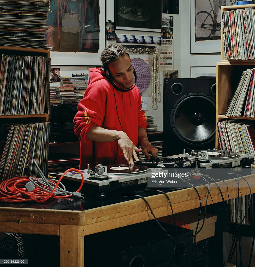 Disc jockey playing record : Stock Photo