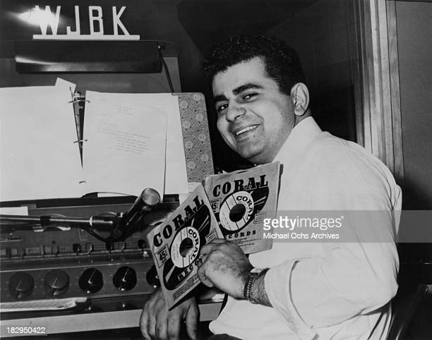 Disc jockey TV personality and actor Casey Kasem in the DJ booth at WJBK radio station in 1957 in Detroit Michigan