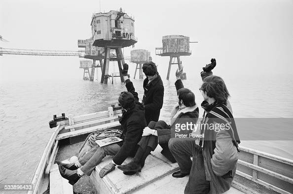 Disc jockeys Eric Martin Alan Clarke Leslie Dunne and Paul Kramer leaving the pirate radio station Radio City which had been based at Shivering Sands...