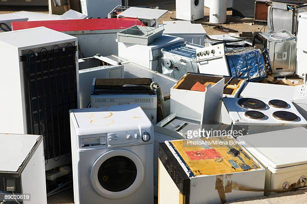 Discarded appliances in junkyard, full frame