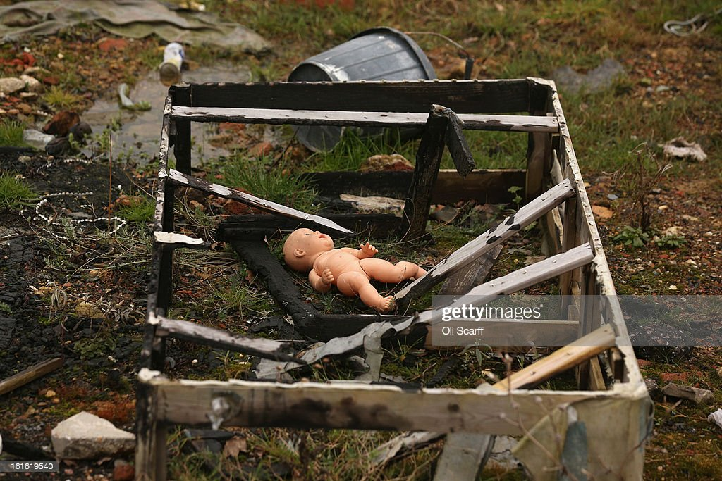 A discarded child's toy doll rest amongst other rubbish on the portion of the Dale Farm traveller's camp which was cleared of residents and structures by Basildon Council on February 13, 2013 in Crays Hill, England. Basildon Council have approved a new site to accommodate the displaced travellers, which lies less than 800 meters from Dale Farm. Following Basildon Council's eviction in October 2011, which was estimated to have cost 7 million GBP, many travellers now reside on the access road for the legal portion of the Dale Farm site.