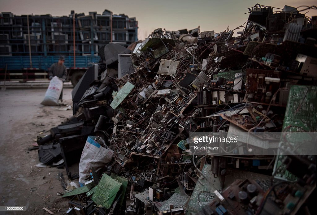 Discarded computer and electronics parts wait to be recycled in the Dong Xiao Kou village on December 11 2014 in Beijing China The village is made up...
