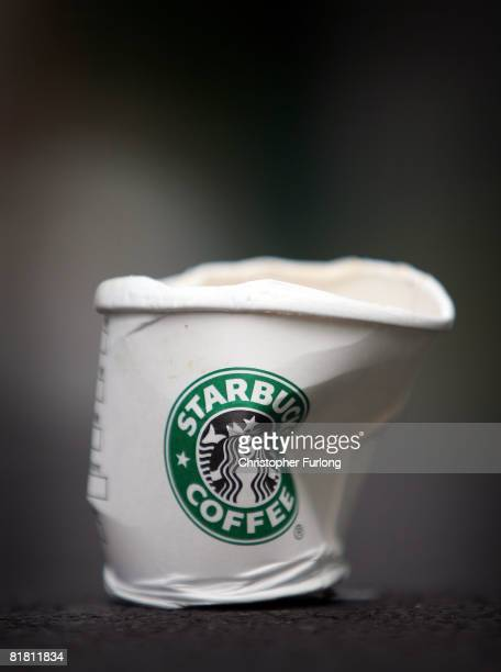A discarded cup of Starbucks coffee lies on the pavement outside in one of company's cafes in Northwich on 3 July 2008 in Northwich England Starbucks...
