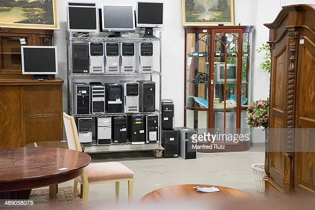 Discarded electronic devices for sale in a charity shop Germany