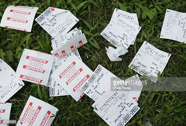 Discarded gambling slips are seen at Saratoga Race Course during opening weekend of the thoroughbred racing season July 26 2003 in Saratoga Springs...