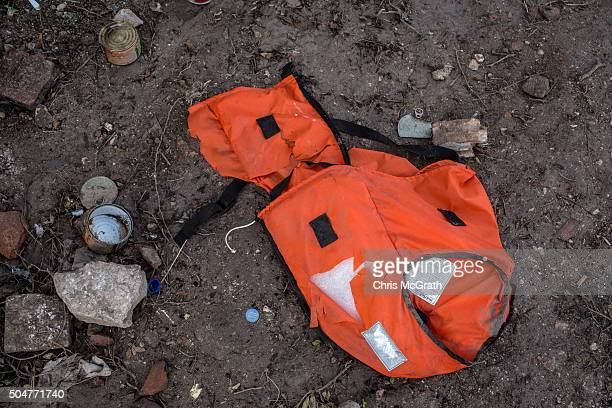 A discarded life jacket is seen left behind at an unfinished resort complex used by refugees and migrants while waiting for smugglers boats to take...