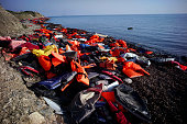 Discarded life jackets on the shore used by migrants making the crossing from Turkey to the Greek island of Lesbos on November 16 2015 in Sikaminias...
