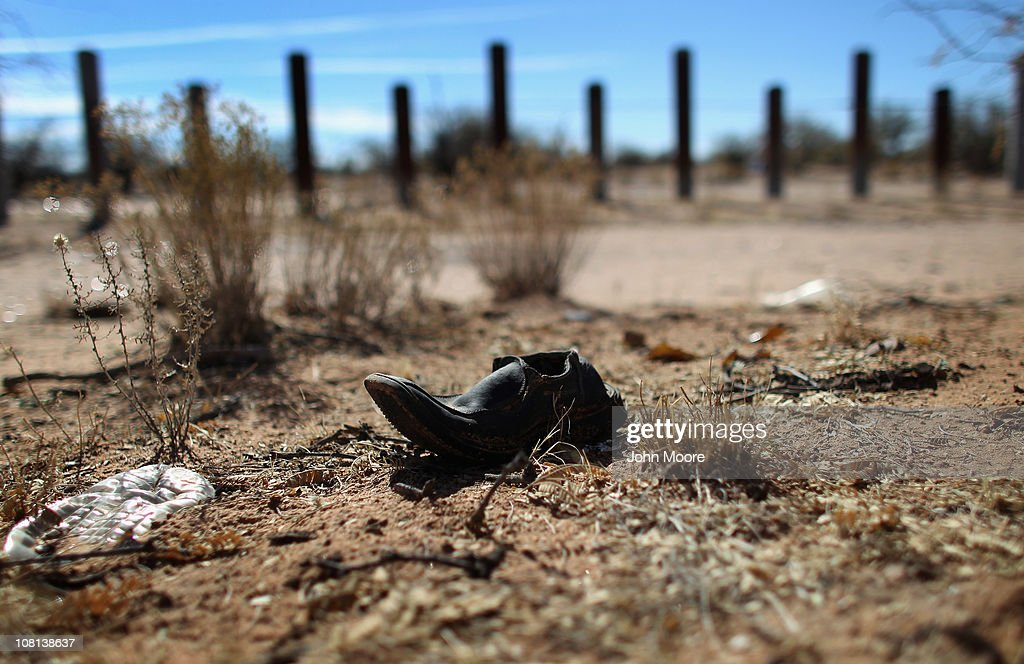 A discarded shoe lies along the porous USMexico border fence which stretches through the Sonoran Desert on January 18 2011 in the Tohono O'odham...