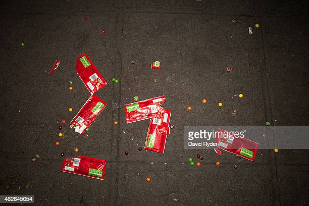 Discarded Skittles candy lies scattered on a sidewalk after Seattle Seahawks fans watched their team fall to the New England Patriots in Super Bowl...
