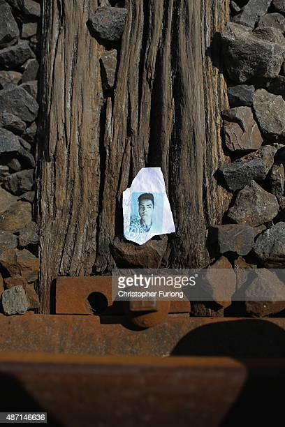 A discarded torn and ripped identity document of a migrant sits on the railway tracks as hundreds of migrants and refugees continue to cross the...