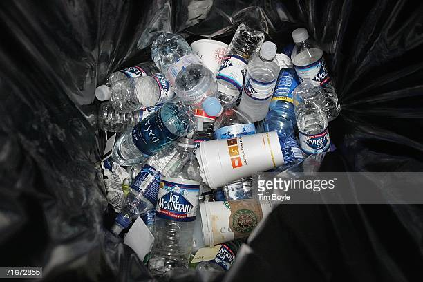 Discarded water bottles and coffee cups sit in a trash bin near a security checkpoint in Terminal One at O'Hare International Airport August 18 2006...