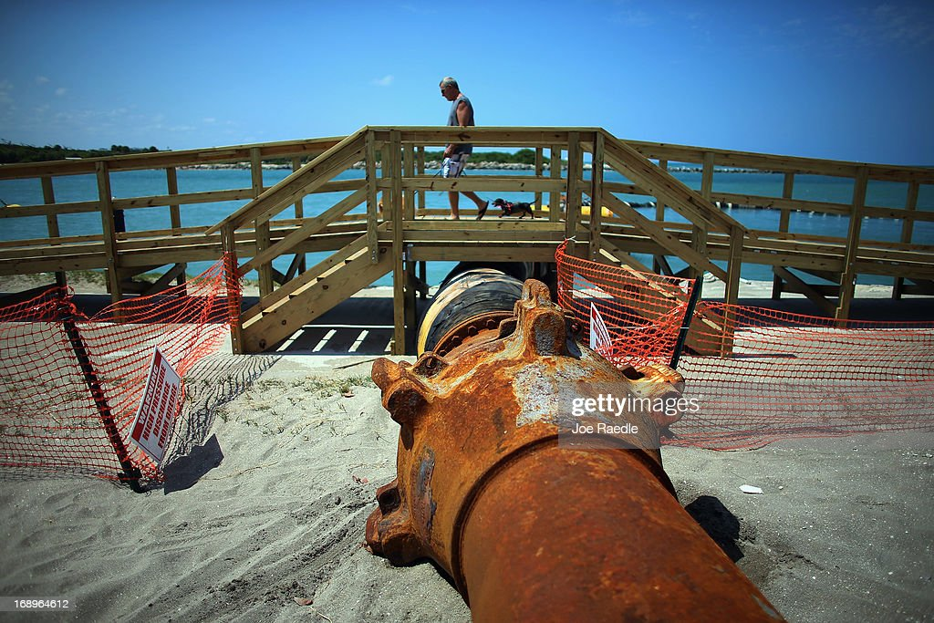 A discharge pipe is used to carry dredged sand into place during a federally funded shore protection project by Great Lakes Dredge and Dock on May 17, 2013 in Fort Pierce, Florida. As cities along the East Coast prepare for the start of the hurricane season, officials say the area encompasing Fort Pierce beach has been in dire need of repair since Hurricane Sandy last year made worse an area already suffering significantly from erosion. Some experts say shore restoration projects can help reduce the physical and economic damage from waves, storm surge, and the resulting coastal flooding in a hurricane.
