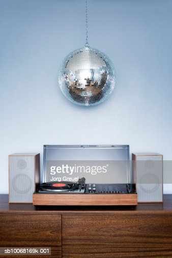 Disco ball hanging over 1970?s stereo system : Stock Photo