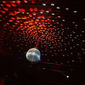 Disco ball reflecting on ceiling at nightclub