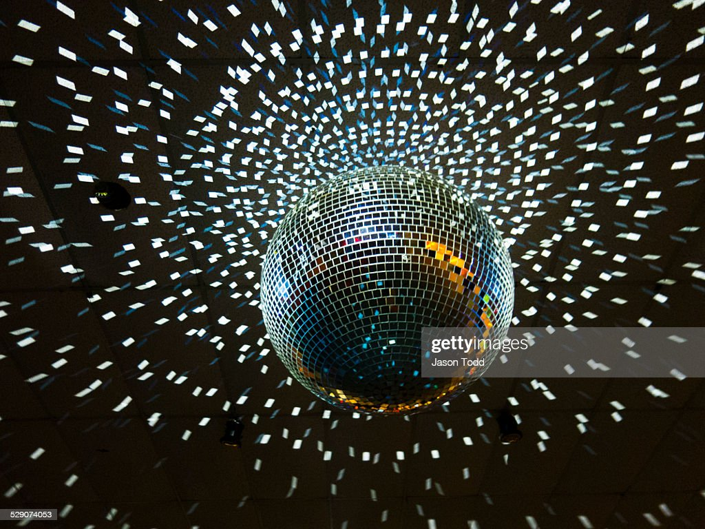 Disco Ball With Lights Hanging From Ceiling Stock Photo