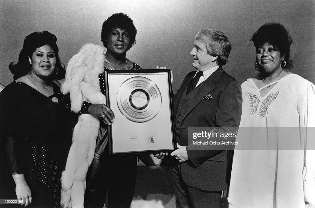 Disco singer Sylvester aka Sylvester James presents a gold 'Step II' album to <a gi-track='captionPersonalityLinkClicked' href=/galleries/search?phrase=Merv+Griffin&family=editorial&specificpeople=206126 ng-click='$event.stopPropagation()'>Merv Griffin</a> during his latest appearance on Griffin's TV talk show along with Sylvester's back up singers from Two Tons o' Fun aka the Weather Girls, Marth Wash (left) and Izora Rhodes (right), in 1978 in Los Angeles, California.