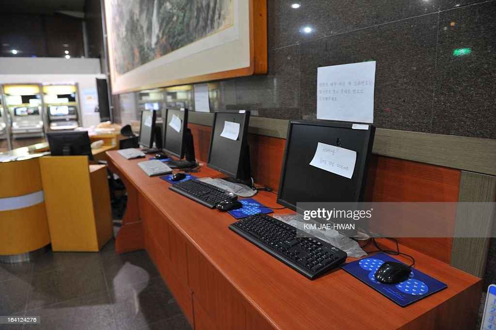 Disconnected computer monitors are seen at a visitors center of Korean Broadcasting System (KBS) headquarters in Seoul on March 20, 2013. The South Korean military raised its cyber attack warning level Wednesday after computer networks crashed at major TV broadcasters and banks, with initial suspicions focused on North Korea.
