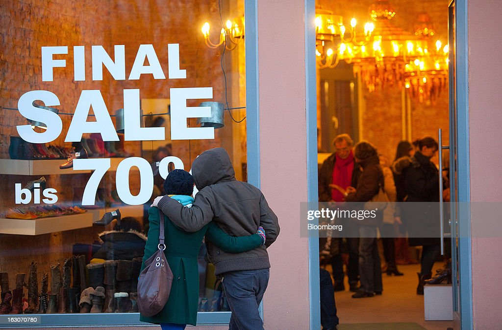 Discount sale signs are seen displayed in the window of a store in Berlin, Germany, on Saturday, March 2, 2013. Germany's 10-year government bonds advanced for a second day even before a report that economists said will show producer prices in the euro area increased for the first time in four months in January. Photographer: Krisztian Bocsi/Bloomberg via Getty Images
