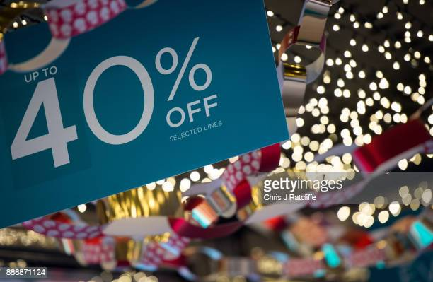 A discount sign is seen outside a shop on Oxford Street on December 9 2017 in London England With two weeks of shopping time left before Christmas...
