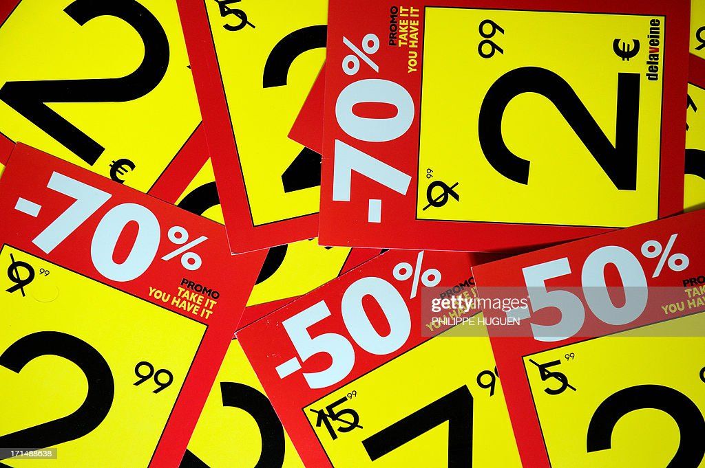 Discount tags are prepared in a store on June 25, 2013 in Lille a day before the start of the summer sales in France.