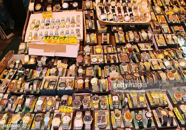 Discount watches are displayed in a shop at Ameyoko market in Tokyo Japan Sep 2013 Ameyoko is a bustling outdoor marketplace and Tokyo's most busiest...