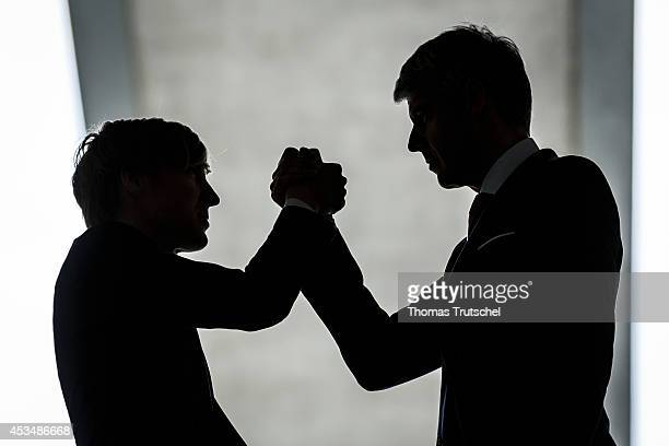 Discuss two men in business business suits on August 07 2014 in Berlin Germany