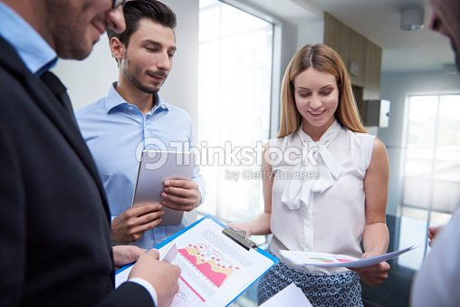Discussing and analyzing important documents : Stock Photo