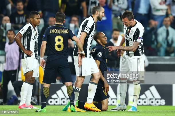 A discussion between Fabinho of Monaco and Mario Mandzukic of Juventus at Juventus Stadium in Turin Italy on May 9 2017