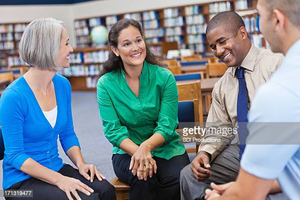 Discussion group laughing together in a library