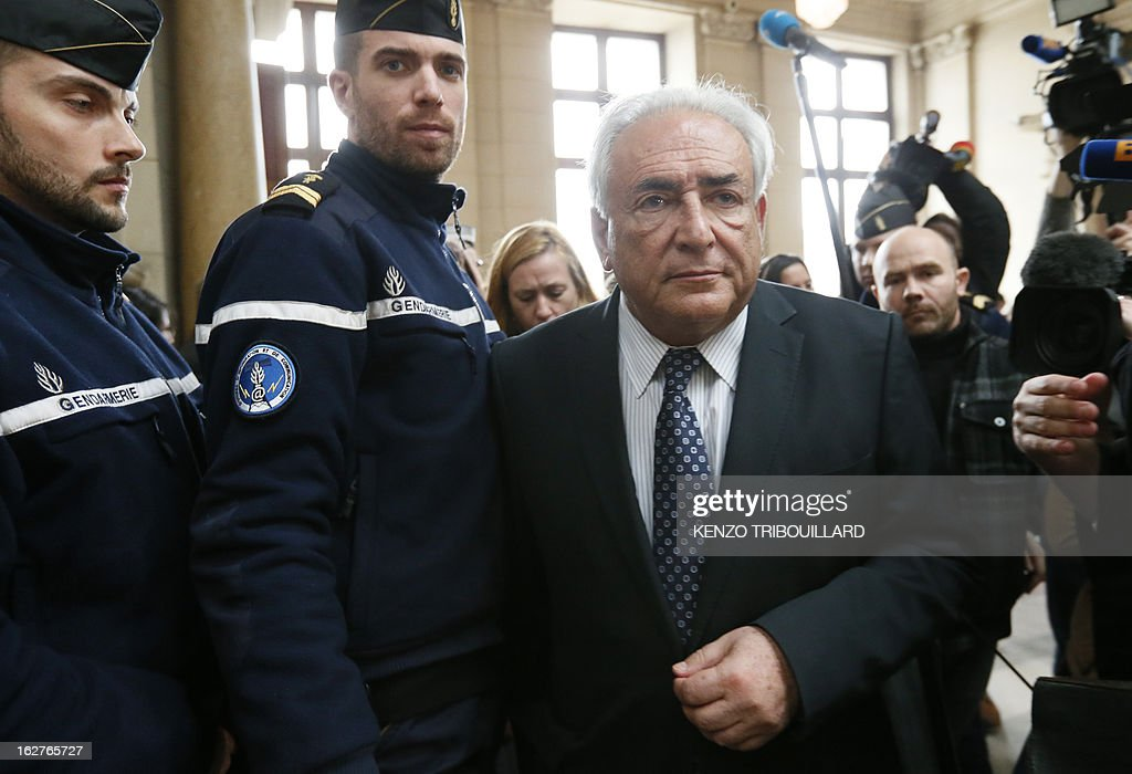 Disgraced former IMF chief Dominique Strauss-Kahn (R) arrives at Paris' courthouse after attending a hearing regarding his seizure request of the new book by Argentinian-born Marcela Iacub detailing their liaison, on February 26, 2013. Strauss-Kahn, who has called the book an 'abomination', is seeking 100,000 euros ($132,300) in damages and compensation from Iacub and her publisher Stock, and a similar amount from Le Nouvel Observateur, a magazine that published excerpts of the book.