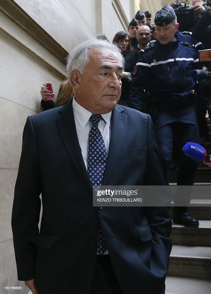 Disgraced former IMF chief Dominique Strauss-Kahn leaves Paris courthouse after attending a hearing regarding his seizure request of the new book by Argentinian-born Marcela Iacub detailing their liaison, on February 26, 2013. Strauss-Kahn, who has called the book an 'abomination', is seeking 100,000 euros ($132,300) in damages and compensation from Iacub and her publisher Stock, and a similar amount from Le Nouvel Observateur, a magazine that published excerpts of the book. AFP PHOTO KENZO TRIBOUILLARD