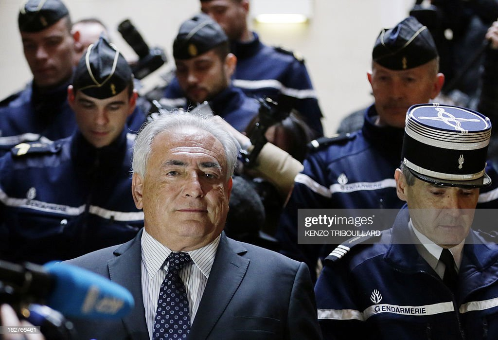 Disgraced former IMF chief Dominique Strauss-Kahn leaves Paris courthouse after attending a hearing regarding his seizure request of the new book by Argentinian-born Marcela Iacub detailing their liaison, on February 26, 2013. Strauss-Kahn, who has called the book an 'abomination', is seeking 100,000 euros ($132,300) in damages and compensation from Iacub and her publisher Stock, and a similar amount from Le Nouvel Observateur, a magazine that published excerpts of the book.