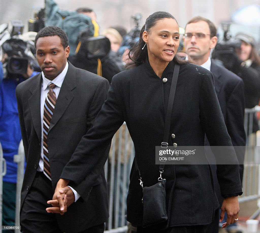 Disgraced former track star Marion Jones enters Federal Court for sentencing 11 January 2008 in White Plains, New York, accompanied by husband Obadele Thompson (L). Prosecutors have indicated they would be satisfied with a six-month jail term, but the judge in the case, who is not bound by the recommendation, has indicated he could order Jones to serve two consecutive sentences.