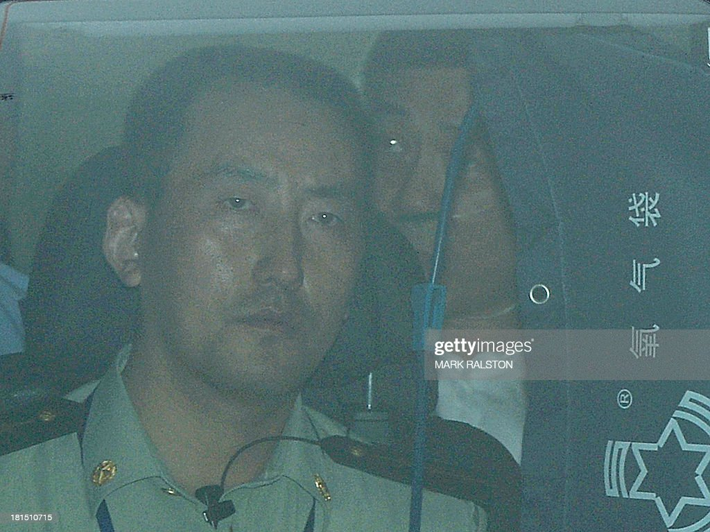 Disgraced politician Bo Xilai (R) is driven from the Intermediate People's Court after being sentenced to life in prison when his verdict was announced in Jinan, Shandong Province on September 22, 2013. Fallen Chinese political star Bo Xilai was sentenced by a court to life in prison, following a sensational scandal that culminated in the country's highest-profile trial in decades. AFP PHOTO/Mark RALSTON